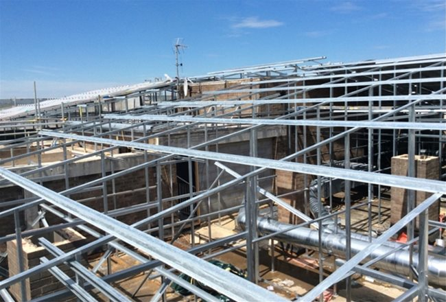 Langley - Sunningdale Court - steel frame spanning existing roof areas of different heights